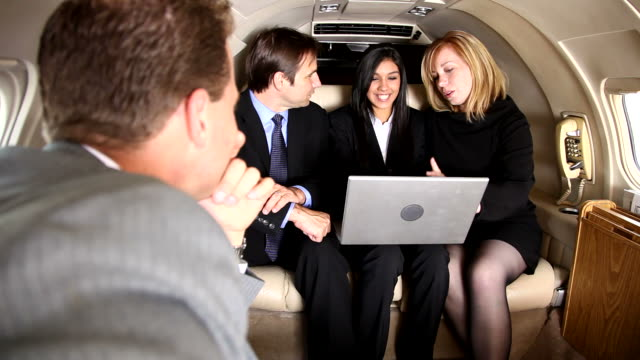 Business team has meeting inside jet video