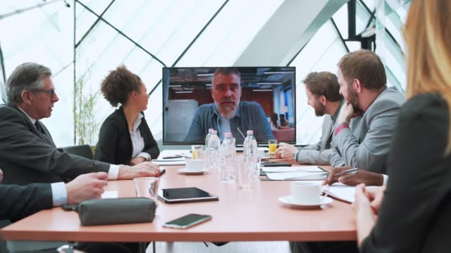 business team having video call with their manager - conference call stock videos & royalty-free footage
