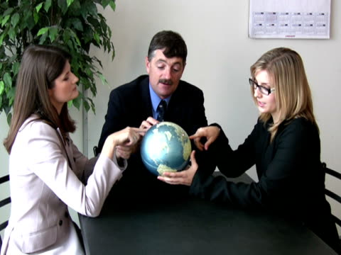 Business Team Holds Up Globe video