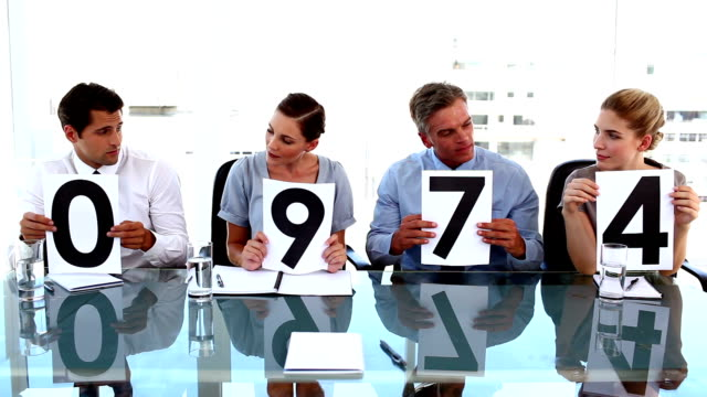 Business team in row giving grade