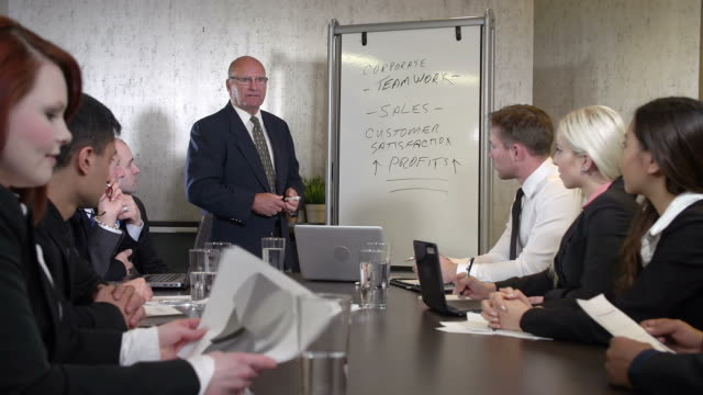 Business team meeting in a boardroom video