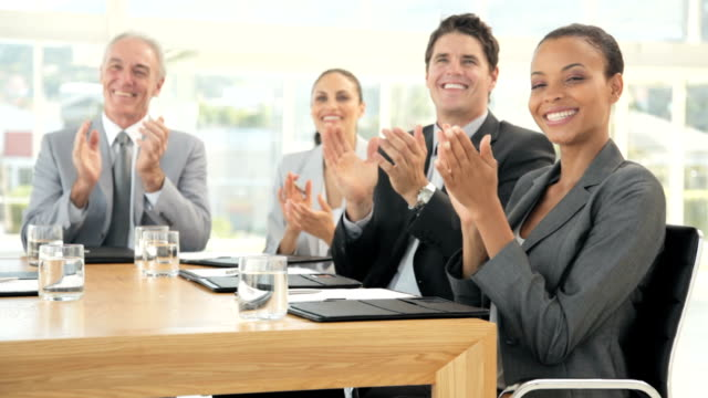 Business Team Smile and Applaud at a Meeting video