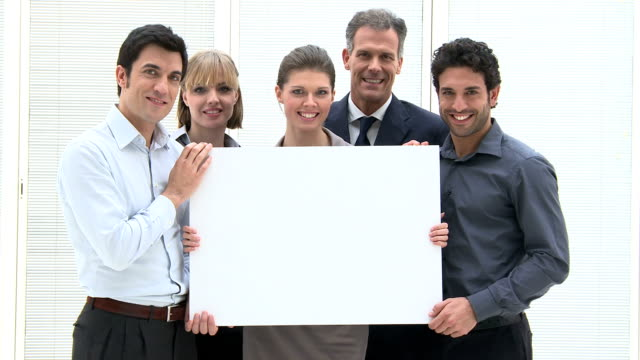 Business team with placard video
