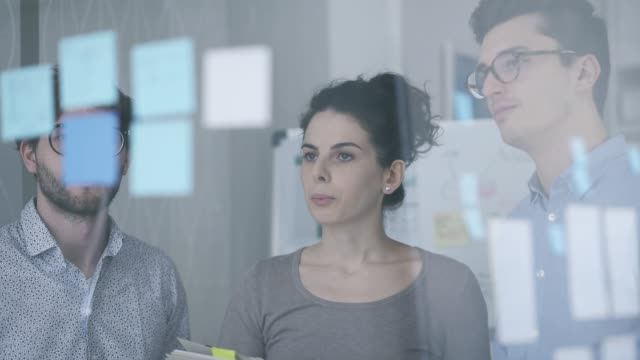 business team working in the office - post it video stock e b–roll
