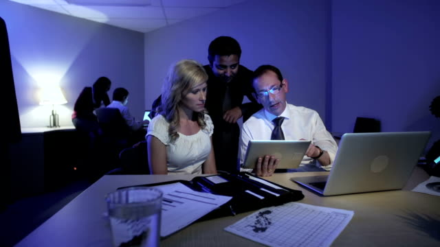 Business team works late into the evening video