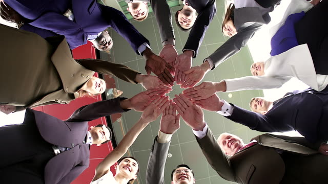 vídeos de stock e filmes b-roll de business teamwork groups of multi-ethnic people stacked hand together, unity concept. shot from bottom view. - uniforme