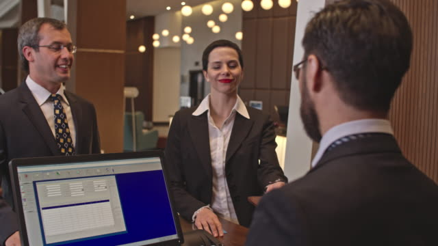Business Visitors at Hotel Check-In video
