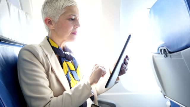 business woman at airplane video