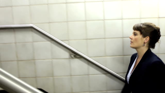 Business Woman Climbs Stairs in Subway Station video