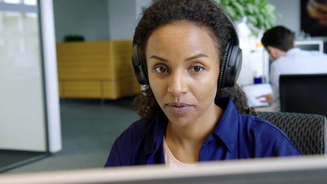 Business woman having a voice chat with client