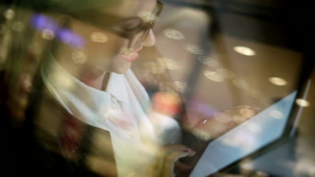 Business woman in car on Paris streets video