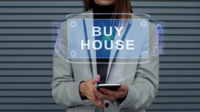 Business woman interacts HUD hologram Buy house