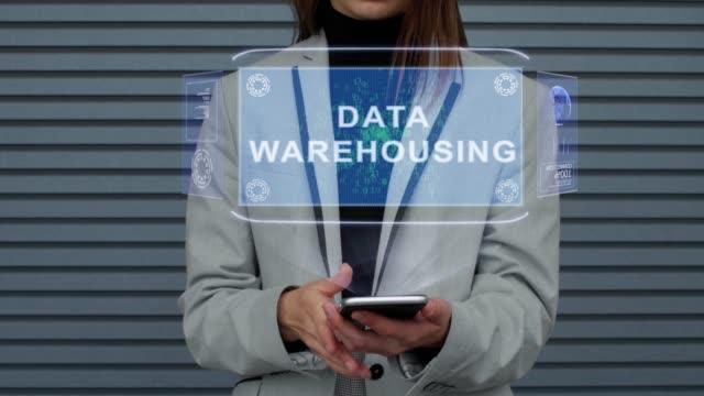 Business woman interacts HUD hologram Data Warehousing