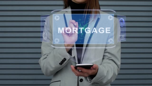 Business woman interacts HUD hologram Mortgage
