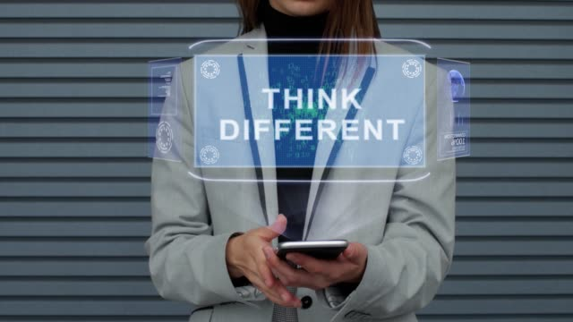 vídeos de stock e filmes b-roll de business woman interacts hud hologram think different - filosofia