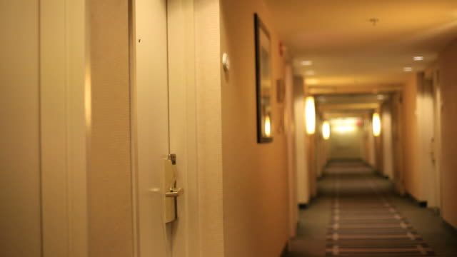 Business woman leaving hotel room video