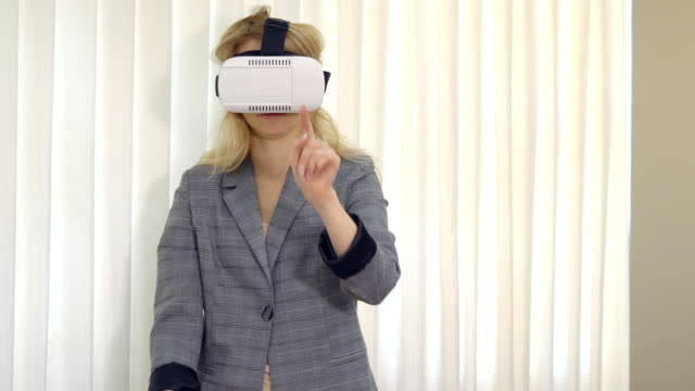 Business woman looking with VR device in office