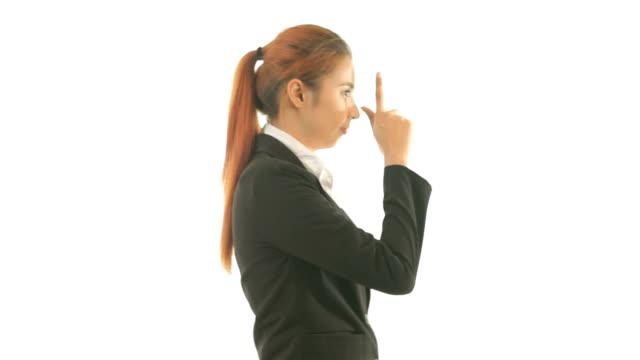 business woman making a gun gesture video