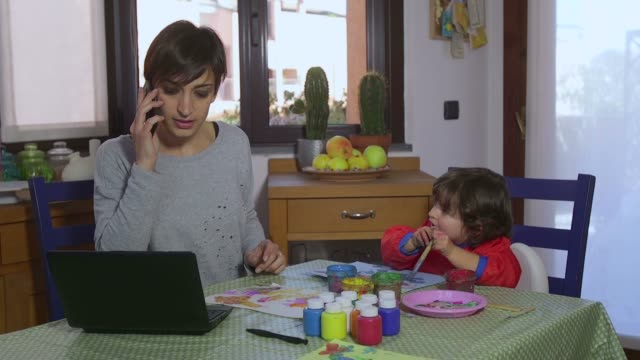 Business Woman Multitasking Mom Working At Home And Child Painting video