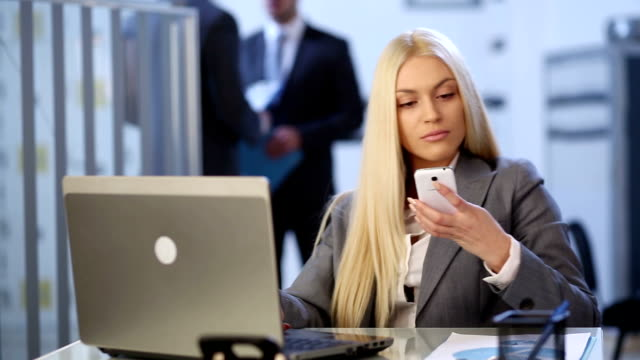 Business woman on telephone video