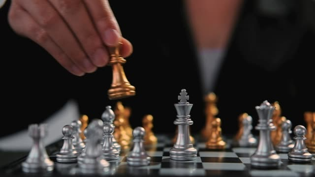 Business woman playing chess battle game Planning of leading strategy successful business leader