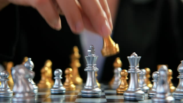 vídeos de stock e filmes b-roll de business woman playing chess battle game planning of leading strategy successful business leader - xadrez