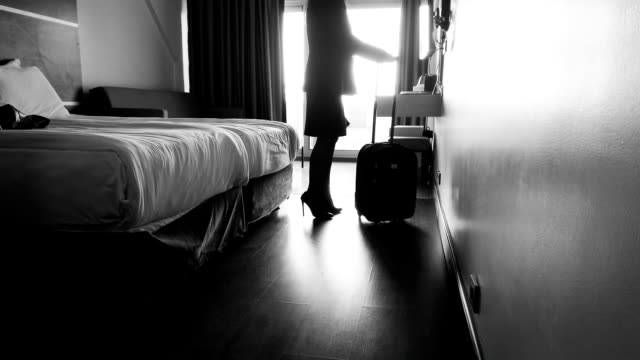 Business woman settles into hotel room