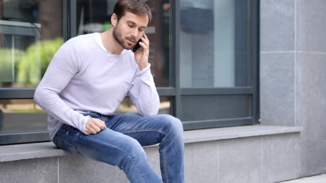 Business Woman Talking on Phone while Sitting Outside Office Building, Discussing video