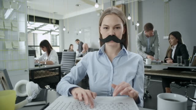 business woman with fake mustaches - baffo peluria del viso video stock e b–roll
