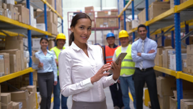 Business woman working at a warehouse video