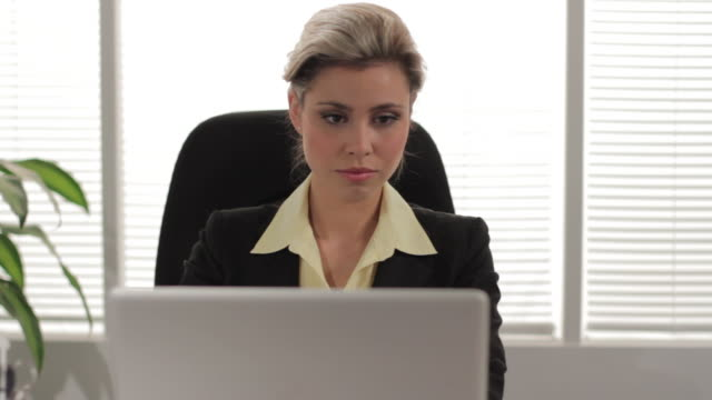 Business woman working at her computer video