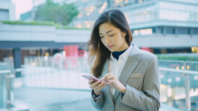 Business woman working on smart phone video