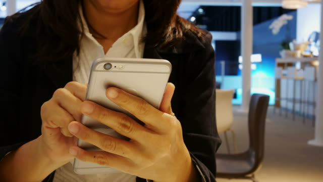 Business woman's hand using smart phone video