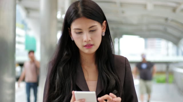 4K : Business women asian using smartphone for relax and shopping online. video