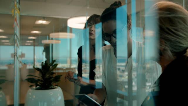 Business women meeting in modern office video