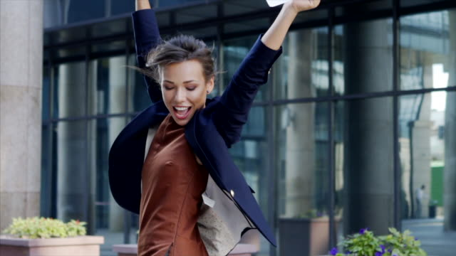 business women on street young business women in black jacket happy and jump on the street with paper blanks in hands, medium shot slow motion accounting stock videos & royalty-free footage