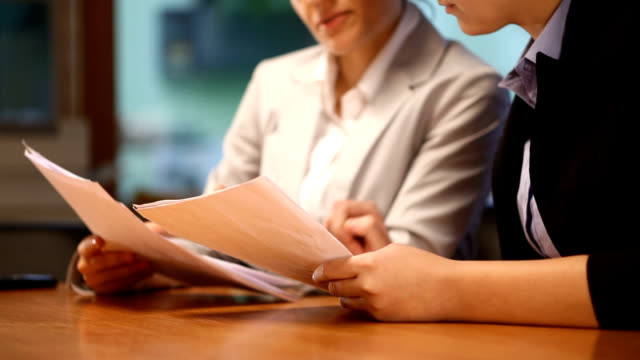 Business women working with documents in office video