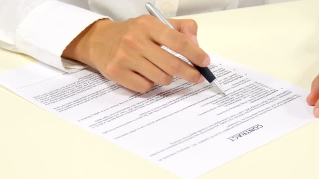 Business worker signing the contract to conclude a deal video