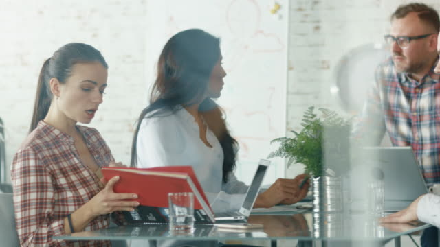Businesslike Creative People Collectively Solving Issues while Sitting in Conference Room. - Vidéo