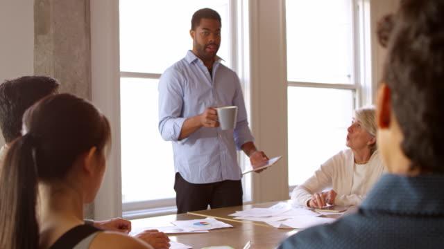 Businessman Addressing Team Meeting Shot On R3D video