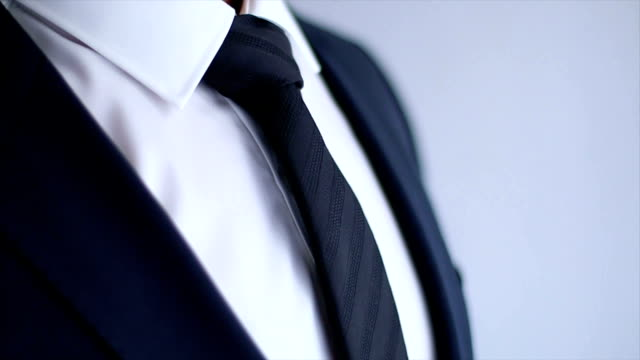Businessman Adjusting His Necktie video