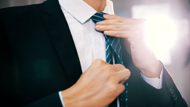 Businessman adjusting tie Businessman adjusting tie neck stock videos & royalty-free footage