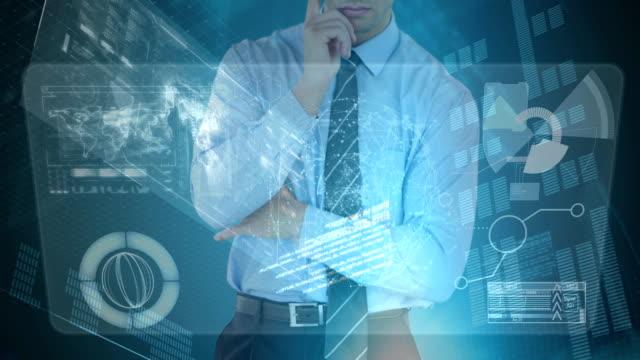 Businessman analysing information with data