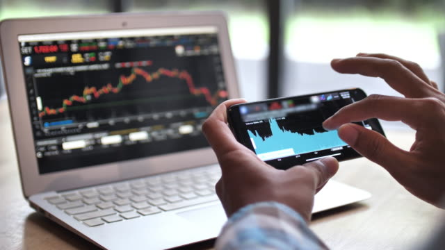 Businessman analysis stock market data with digital tablet and laptop in office