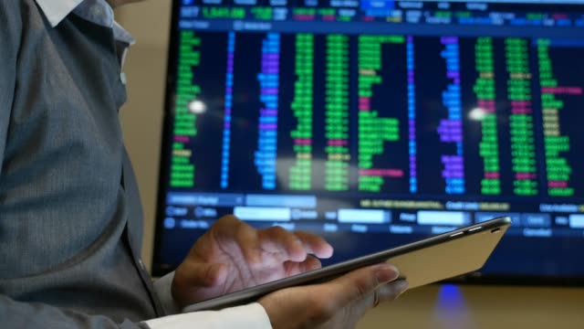 businessman analysis stock market data with digital tablet and laptop in office - stock broker stock videos & royalty-free footage