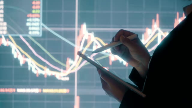 Businessman analysis stock market data with digital tablet Businessman analysis stock market data with digital tablet financial building stock videos & royalty-free footage