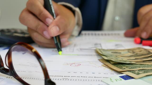 Businessman analyzing Financial Report, Dolly shot