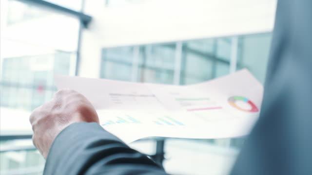 Businessman analyzing financial reports.