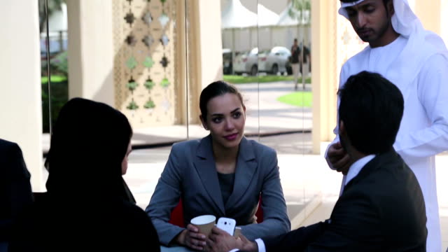 Businessman and Business woman discussing on the table video