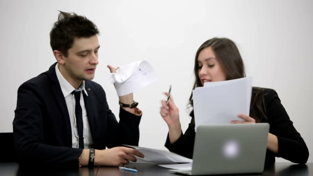 Businessman and businesswoman are arguing about a documents and ideas video